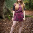 Portrait of a Beautiful Teenage Girl Standing in a Forest — Stock Photo #60819067