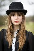 Beautiful Young Woman Dressed In Black Wearing Bowler Hat — Stock Photo