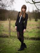 Beautiful Young Woman Dressed In Black in a Field — Stock Photo
