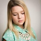 Teenage blond girl looking down — Stock Photo
