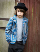 Boy with Hat Leaning Against the Wall — Stock Photo