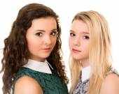 Portrait of two beautiful teenage sister girls with brown eyes a — Stockfoto
