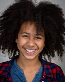 Mixed Race Girl With Afro Hair Style Laughing — Stock Photo