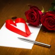 Ribbon Love Heart On Paper With Pen And Roses — Stock Photo #61904491