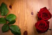 Two Valentine Roses With Leaf On Wood — Stock Photo