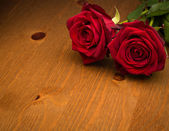 Two Red Roses On Brown Wood — Stock Photo
