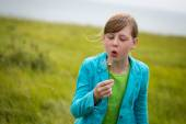 Young Girl Blowing A Dandelion — Stock Photo