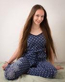 Beautiful Brunette Teenage Girl In Blue Pajamas — Stock Photo