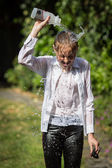 Teenage Girl Cools Down By Throwing Water Over Her Head — Стоковое фото