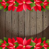 Wooden background with poinsettia borders — Vector de stock