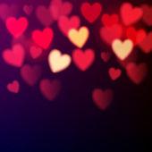 Corações brilhantes bokeh — Vetor de Stock