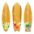 Wooden surfboards with floral prints — Stock Vector #70301541