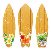 Wooden surfboards with floral prints — Stock Vector