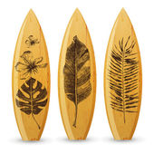 Wooden surfboards with hand drawn tropical leaves — Stock Vector