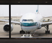 Cathay Pacific passenger airplane at the airport — Stock Photo