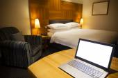 Laptop in a luxurious hotel room — Стоковое фото