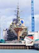 Destroyer under construction in a naval shipyard — Stock Photo