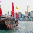 Hong Kong skylines and junk boat — Stock Photo #63720185