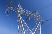 Electricity pylon against blue sky — Stock Photo