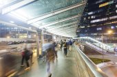Commuters walking along an elevated walkway — Stock Photo