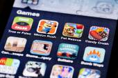 Close-up image of an iPhone screen with icons of game apps — Stock Photo