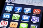 Close-up image of an iPhone screen with icons of social media apps — Stock Photo