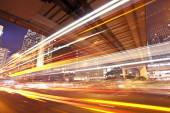 Traffic trails of double decker traveling on a busy road — Stock Photo