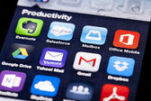 Close-up image of an iPhone screen with icons of productivity apps — Stock fotografie