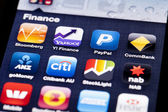 Close-up image of an iPhone screen with icons of finance apps — Stock Photo