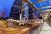 Fisheye view of city at night with traffic trails — Stock Photo