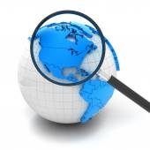 Globe with magnifying glass over north america and USA — Stockfoto