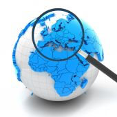 Globe with magnifying glass over Europe — Stock Photo