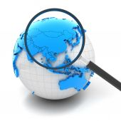 Globe with magnifying glass over China and Asia — Stock Photo