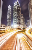 Hong Kong at night with traffic trails — Stock Photo