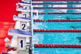 Swimming pool starting blocks — Stock Photo