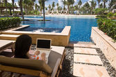 Using computer at hotel lagoon room — Stock Photo
