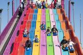 People enjoying a giant slide — Stock Photo