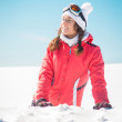 Young woman skier enjoying the snow smiling and sunbathing — Stock Photo #65800509
