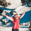 Woman explorer skier in mountains with snowy background — Stock Photo #66093421