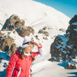 Woman explorer skier in mountains with snowy background — Stock Photo #66093729