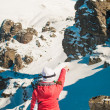 Woman explorer skier in mountains with snowy background — Stock Photo #66093823