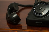 Old retro black telephone on desk — Stock Photo