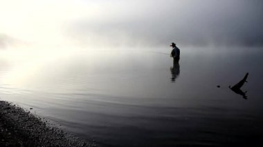 Fly fishing in the lake — Stock Video
