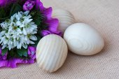 Snowdrop flowers and wooden eggs — Stock Photo