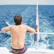 Man on yacht look at the water in high Red sea — Stock Photo #70652951