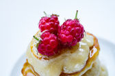 Stack of pancakes with three raspberries and honey, close up — Stock Photo