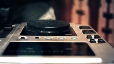 DJ at a console booth spinning and touching mixer faders and knobs — Wideo stockowe