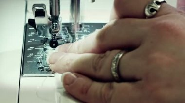 Woman hand sewing a white textile — Stock Video