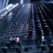 Audio Engineer sticking tape to his mixing console desk. — Stock Video #67510237