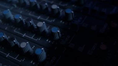 Close-up panning shot of EQ Knobs on a mixing console desk. — Stock Video